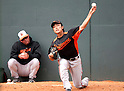 Tsuyoshi Wada (Orioles), MARCH 9, 2012 - MLB : Baltimore Orioles' pitcher Tsuyoshi Wada practices pitching in the bullpen as pitching coach Rick Adair (L) watches him during the Baltimore Orioles spring training camp at Ed Smith Stadium in Sarasota, Florida, United States. (Photo by Thomas Anderson/AFLO) (JAPANESE NEWSPAPER OUT)