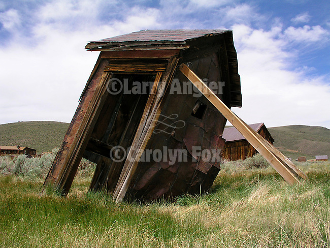 Propped up leaning wooden outhouse in the ghost town of Bodie, Calif.