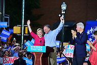 Harrisburg, PA - July 29, 2016: Democratic presidential nominee Hillary Clinton and vice presidential candidate Tim Kaine greet supporters in Harrisburg, PA, during a campaign stop on the Clinton/Kaine bus tour July 29, 2016. Bill Clinton and Kaine's wife Anne Holton (r) also appeared during the campaign stop.  (Photo by Don Baxter/Media Images International)