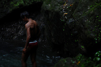 Filipino man at a waterfall in Ilocos Norte, Philippines..**For more information contact Kevin German at kevin@kevingerman.com