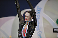 """September 11, 2009; Mie, Japan;  Anna Bessonova of Ukraine waves to fans from """"kiss & cry"""" during individual All Around final at the 2009 World Championships Mie, Japan. Anna (the 2007 Patras world champion) placed 3rd in the AA final on this day at Mie.  Photo by Tom Theobald."""