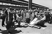 INDIANAPOLIS, IN: Janet Guthrie waits to drive her Lightning 76 1/Offenhauser TC during practice for the Indianapolis 500 on May 29, 1977, at the Indianapolis Motor Speedway.