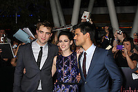 "LOS ANGELES - NOV 14:  Robert Pattinson, Kristen Stewart, Taylor Lautner arrives at the ""Twilight: Breaking Dawn Part 1"" World Premiere at Nokia Theater at LA LIve on November 14, 2011 in Los Angeles, CA"