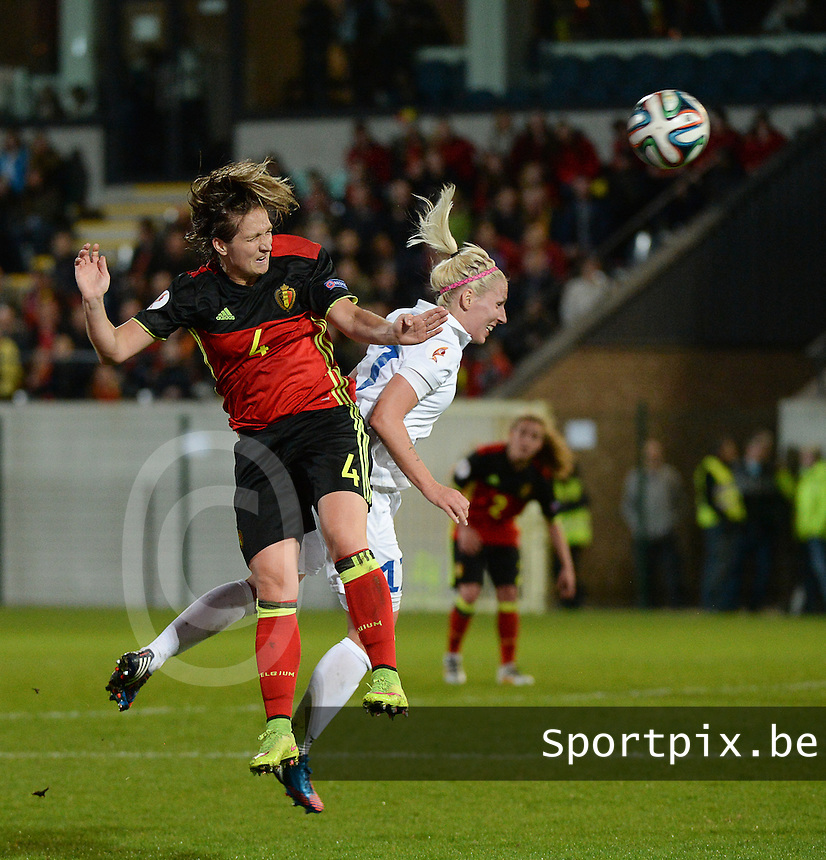 20160412 - LEUVEN ,  BELGIUM : Belgian Maud Coutereels (L) and Estonian Eneli Vals (R) pictured during the female soccer game between the Belgian Red Flames and Estonia , the fifth game in the qualification for the European Championship in The Netherlands 2017  , Tuesday 12 th April 2016 at Stadion Den Dreef  in Leuven , Belgium. PHOTO SPORTPIX.BE / DIRK VUYLSTEKE
