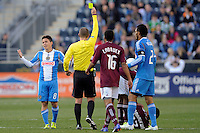 Roger Torres (8) of the Philadelphia Union receives a yellow card from referee Mark Geiger. The Colorado Rapids defeated the Philadelphia Union 2-1 during a Major League Soccer (MLS) match at PPL Park in Chester, PA, on March 18, 2012.