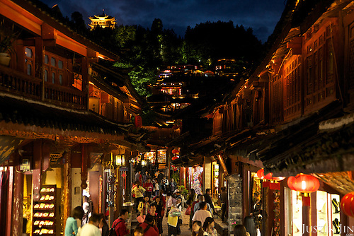 Restaurants and shops along a stream at the ancient Lijiang town in Yunnan province, southwestern China.