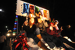 Riders wave from the North Mississippi Regional Center's float in the Christmas parade in Oxford, Miss. on Monday, December 3, 2012.
