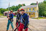 "Old Bethpage, New York, USA. 30th August, 2015. At center, Andrew Preble from Long Beach portrays an American Civil War Captain from the 14th Brooklyn Regiment (14th New York State Militia) AKA The Brooklyn Chasseurs, in front of the yellow and white Noon Inn during the Old Time Music Weekend at the Old Bethpage Village Restoration. During their historical reenactments, members of the non-profit 14th Brooklyn Company E wear reproductions of ""The ""Red Legged Devils"" original Union army uniform."
