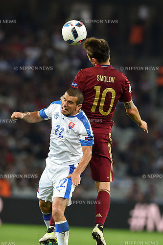 Fedor Smolov (Russia) Viktor Pecovsky (Slovakia) ; <br /> June 15, 2016 - Football : Uefa Euro France 2016, Group B, Russia 1-2 Slovakia at Stade Pierre Mauroy, Lille Metropole, France. (Photo by aicfoto/AFLO)