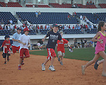 Kids run the bases following the Ole Miss vs. Wright State at Oxford University Stadium in Oxford, Miss. on Sunday, February 20, 2011. Ole Miss won 6-5 to improve to 3-0 on the season.