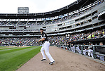 CHICAGO - OCTOBER 03:  Paul Konerko #14 of the Chicago White Sox runs onto the field by himself as his teammates look on the game against the Cleveland Indians on October 03, 2010 at U.S. Cellular Field in Chicago, Illinois.  The White Sox defeated the Indians 6-5.  (Photo by Ron Vesely)