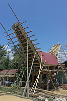 construction of a traditional house called Tongkonan,  Toraja land, Sulawesi, Indonesia. Bamboo is one of the major materials used for construction.