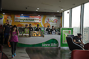 Employees of the Joost, a juice bar wait for customers at the counter of a fitness club in New Delhi, India.