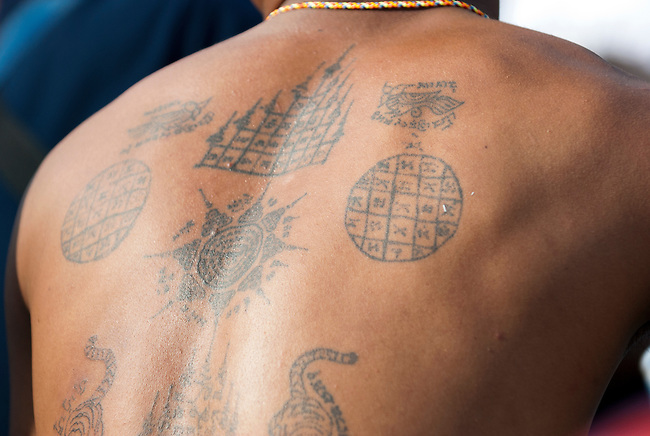 Nakorn Chai Sri, Thailand, March 3, 2012, Wat Bang Phra - Sak Yant tattoos adorn the body of devotees at the annual Wai Khru festival to recharge the magical powers in their tattoos.