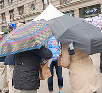 "Thousands of donut lovers flock to Flatiron Plaza in New York to celebrate  National Donut Day on Friday, June 5, 2015. Supported by Entenmann's, the bakers gave out 40,000 chocolate donuts and donated $30,000 to the Salvation Army. National Donut Day, the first Friday in June, was created in 1938 by the Salvation Army to honor the ""donut lassies"" who administered treats and solace to soldiers during WW1. Entenmann's is a division of Bimbo Bakeries USA. (©  Richard B. Levine)"