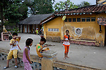 Children play outside teh Giac Vien Pagoda in District 11 in Ho Chi Minh City, Vietnam. Photo taken Monday, May 3, 2010...Kevin German / LUCEO