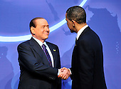 United States President Barack Obama welcomes President Silvio Berlusconi of Italy to the Nuclear Security Summit at the Washington Convention Center, Monday, April 12, 2010 in Washington, DC. .Credit: Ron Sachs / Pool via CNP