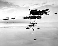 USS ESSEX based TBMs and SB2Cs dropping bombs on Hokadate, Japan.  July 1945.  (Navy)<br /> Exact Date Shot Unknown<br /> NARA FILE #:  080-G-490232<br /> WAR &amp; CONFLICT BOOK #:  1238