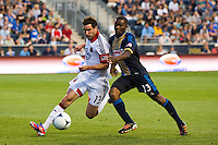 Chris Pontius (13) of DC United is marked by Michael LaHoud (13) of the Philadelphia Union. DC United defeated Philadelphia Union 1-0 during a Major League Soccer (MLS) match at PPL Park in Chester, PA, on June 16, 2012.