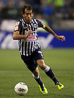 César Delgado CF Monterrey dribbles the ball during a CONCACAF Champions League match against the Seattle Sounders FC at CenturyLink Field in Seattle Tuesday Oct. 18, 2011. CF Monterrey won the game 2-1.