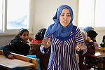 Samera Al-Sarhan teaches a class in the Zaatari Refugee Camp, located near Mafraq, Jordan. Opened in July, 2012, the camp holds upwards of 50,000 refugees from the civil war inside Syria. International Orthodox Christian Charities and other members of the ACT Alliance are active in the camp providing essential items and services.