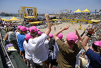Huntington Beach, CA - 5/5/07:   Fans pay homage to beach volley legend Karch Kiraly as he makes his entrance Saturday during the 2007 AVP CROCS Tour in Huntington Beach. It was Kiraly's last Huntington Beach Open..Photo by Carlos Delgado