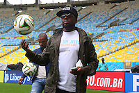Artist Wyclef Jean plays on the Maracana pitch ahead of tomorrow's FIFA World Cup final Germany vs Argentina where he will perform during the closing ceremony