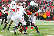 College Park, MD - November 26, 2016: Maryland Terrapins running back Wes Brown (5) gets tackled by several Rutgers Scarlet Knights defenders during game between Rutgers and Maryland at  Capital One Field at Maryland Stadium in College Park, MD.  (Photo by Elliott Brown/Media Images International)