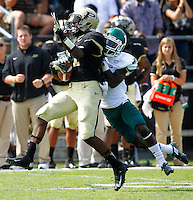 WEST LAFAYETTE, IN - SEPTEMBER 15:  Running back Akeem Hunt #11 of the Purdue Boilermakers is tackled from behind by defensive back Darius Scott #1 of the Eastern Michigan Eagles at Ross-Ade Stadium on September 15, 2012 in West Lafayette, Indiana. (Photo by Michael Hickey/Getty Images)***Local Caption***Akeem Hunt ; Darius Scott