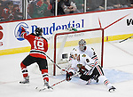 Mar 17, 2009; Newark, NJ, USA; New Jersey Devils center Travis Zajac (19) scores a goal during the first period at the Prudential Center.