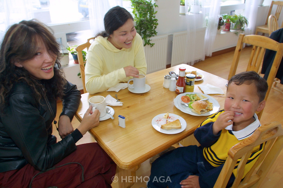 ULAN BATOR, MONGOLIA..08/22/2001.Millie's restaurant. Famous pop singer Sarantuya (l.) with son and amah..(Photo by Heimo Aga)