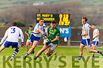 Skellig Rangers Diarmuid Keating in attack mode challenged by here by St Mary's Conor Quirke.