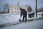 Henry Liggins clears snow from in front of First National Bank in Oxford, Miss., on Monday, January 10, 2011.