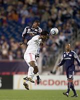 New England Revolution midfielder Joseph Niouky (23) and Toronto FC midfielder Amadou Sanyang (22) battle for head ball. The New England Revolution defeated Toronto FC, 4-1, at Gillette Stadium on April 10, 2010.