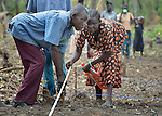A woman and man who fled political conflict in the Democratic Republic of the Congo measure a plot of land as they learn new agricultural techniques in a refugee camp in Panyume, South Sudan. The class is conducted by World Renew, a member of the ACT Alliance, which also provides participants with seeds and tools. South Sudan is hosting refugees from neighboring countries at the same time tens of thousands of South Sudanese have fled the country in the wake of political violence that broke out in December 2013. That conflict quickly ripped apart regions of the young nation along ethnic and tribal lines. The ACT Alliance is providing a variety of services to both refugees and internally displaced families throughout the country.