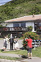 August 25, 2011, Ishigaki, Japan - Tourists take pictures of a cafe on Ishigaki, Japans southern most island in the East China Sea, on Thursday, August 25, 2011.<br /> Cafe TOMURU is owned by Shinsuke Shimada, one of Japans most sought-after TV hosts, who abruptly announced his retirement at a late night news conference in Tokyo on Tuesday, August 23, 2011, over alleged ties with organized crime. The 55-year-old punk-turned-comedian had hosted six TV shows broadcast in Osaka and Tokyo. His sudden exodus left TV major stations scrambling to edit or cancel the programs. (Photo by Wataru Kobayakawa/AFLO).