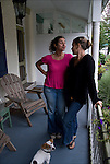 Full lengh portrait of Leigh and Helena outdoors on their front porch in Philadelphia