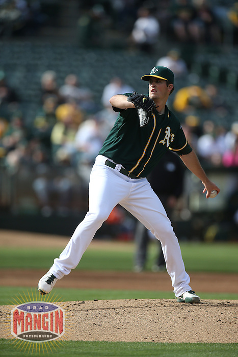 OAKLAND, CA - MAY 7:  Drew Pomeranz #13 of the Oakland Athletics pitches against the Seattle Mariners in game two of a doubleheader at O.co Coliseum on Wednesday, May 7, 2014 in Oakland, California. Photo by Brad Mangin