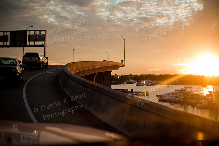 Sunset over the intra coastal wateray in Charleston South Carolina while passing over a bridge to James Island Wapoo Cut