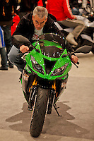 New york, United States. 18th January 2013 -- A man tests a Kawasaki motorcycle during The International Motorcycle Show in New York. -- BMW, Ducati, Harley-Davidson, Honda, Kawasaki, Suzuki, Star, Triumph, Victory, Yamaha and more have all utilized the International Motorcycle Shows to unveil new motorcycles and concept vehicles to the world. Photo by Eduardo Munoz Alvarez / VIEWpress.