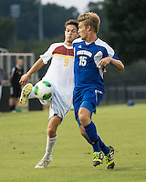 Winthrop University Eagles vs the Brevard College Tornados at Eagle's Field in Rock Hill, SC.  The Eagles beat the Tornados 6-0.  Mason Lavallet (9) and Alec Goetti (15) vie for the ball.