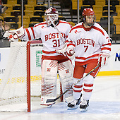 Kieran Millan (BU - 31), Max Nicastro (BU - 7) - The Harvard University Crimson defeated the Boston University Terriers 5-4 in the 2011 Beanpot consolation game on Monday, February 14, 2011, at TD Garden in Boston, Massachusetts.