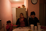 A maquiladora worker family has dinner at their home.