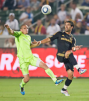 CARSON, CA – July 4, 2011: Seattle Sounders midfielder Osvaldo Alonso (6) and LA Galaxy forward Juan Pablo Angel (9) during the match between LA Galaxy and Seattle Sounders FC at the Home Depot Center in Carson, California. Final score LA Galaxy 0, Seattle Sounders FC 0.