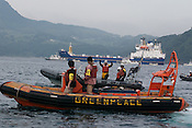 ACTION AGAINST BNFL SHIP 'PACIFIC PINTAIL' AS IT COLLECTS REJECTED PLUTONIUM MOX fuel FROM THE TAKAHAMA NUCLEAR PLANT IN UICHIURA BAY, TAKAHAMA, JAPAN...... aboard the Greenpeace ship Arctic Sunrise, in Takahama Bay, in Japan. 4th July 2002.