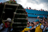 """People try to see the traditional """"Silletero"""" parade during the Flower Festival in Medellin August 7, 2012. Photo by Eduardo Munoz Alvarez / VIEW."""