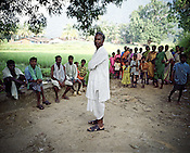Kumati Majhi, a local leader opposing the Vedanta mining is seen talking to the local Kondh villagers. The villagers have set up a makeshift gate to stop Vedanta officials to go across to the proposed area for mining in the Niyamgiri hill is seen in Lanjigarh, Orissa.