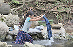 A young woman washes clothes in a river in Victoria 20 de enero, a village of former Guatemalan refugees in Mexico who returned home as a group in 1993, while the country's bloody civil war still raged.