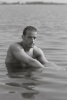 portrait of a man in a shallow lake in The Hamptons
