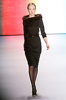 Siri Tollerød walks runway in an outfit from the Carolina Herrera Fall 2011 collection, during Mercedes-Benz Fashion Week Fall 2011.